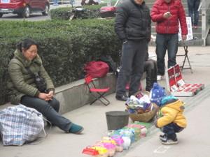 中国事情(路上の物売り、物乞い...